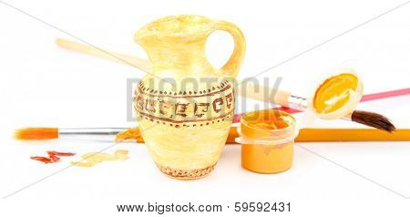 Hand made ceramic amphora and color paints isolated on white