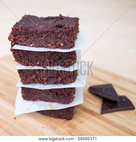 Homemade Chocolate Brownies Stacked On Beige