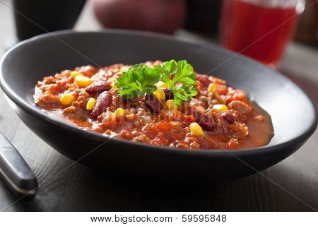 mexican chili con carne in black plate