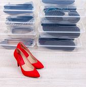 stock photo of shoe-box  - Shoes in plastic boxes and female shoes on floor in room - JPG