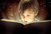 stock photo of curtain  - Child opened a magic book - JPG