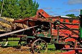 stock photo of threshing  - The old threshing machine is belted up and ready for harvest - JPG