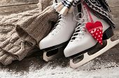 picture of skate board  - White ice skates on old wooden boards