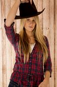 Sultry Blond Model Wearing A Cowboy Hat Barnwood Background