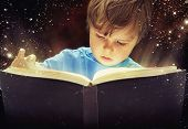 stock photo of little boys only  - Child opened a magic book - JPG