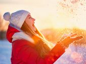 picture of mood  - Beauty Winter Girl Blowing Snow in frosty winter Park - JPG