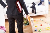 picture of heavy bag  - An elegant woman with grocery shopping left in a messy home - JPG