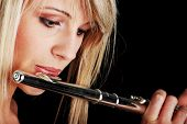 picture of transverse  - Portrait of a woman playing transverse flute - JPG