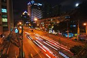 BANGKOK, THAILAND - JULY 30, 2007: Night scenery of one of the central streets of Bangkok. In the ce