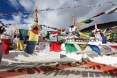 stock photo of himachal  - Prayer flags with stupas  - JPG