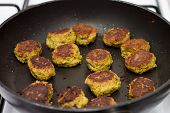 Falafels Frying In A Black Pan