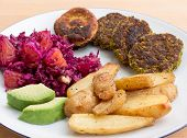 Plate Of Salad, Falafel, Avocado And Baked Potatoes