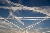 Airplane Trails Of Condesed Air In The Sky
