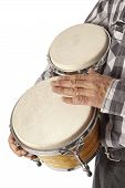 stock photo of drum-set  - Male figure playing and drumming on bongo set under the arm - JPG
