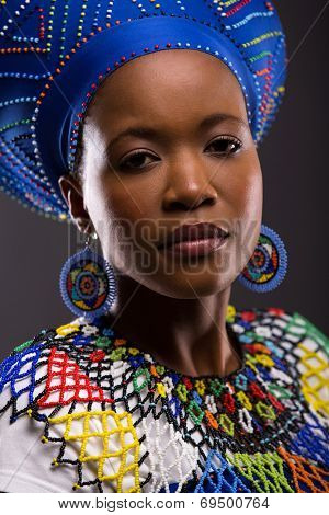 beautiful young african zulu lady looking at the camera on black background