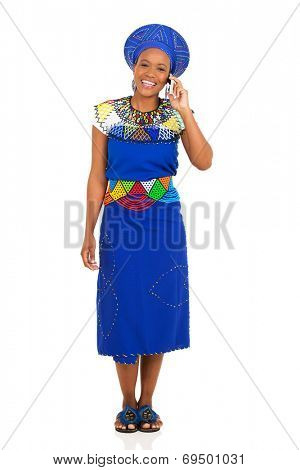 full length portrait of african zulu woman talking on mobile phone