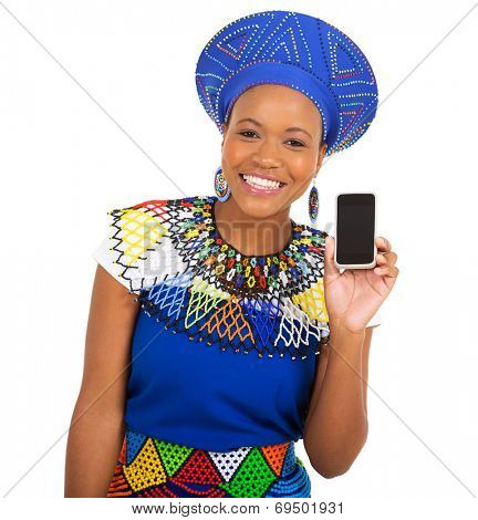 cheerful african girl in traditional clothes showing smart phone