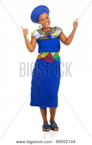 happy young african zulu woman in traditional clothes giving thumbs up