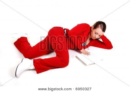 Girl Lying On Floor And Reading.