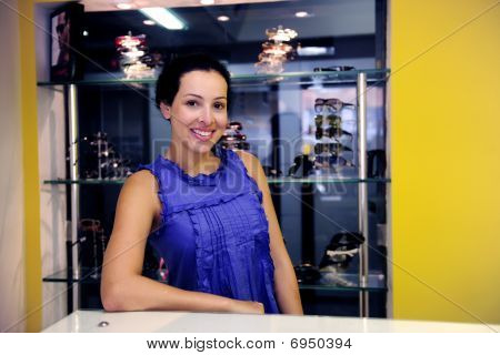 Portrait Of An Optometrist Inside Her Store