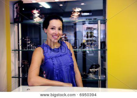 Portrait Of An Optometrist Inside Her Store
