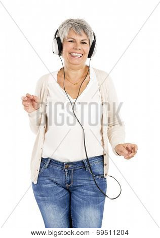 Elderly woman dancing while listen music with headphones, isolated over white background