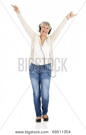 Happy elderly woman listen music with headphones, isolated over white background