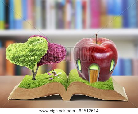 Open book in green grass, nature