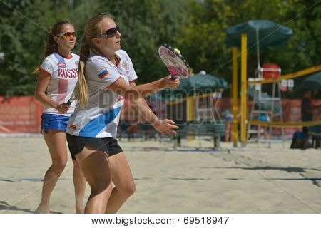 MOSCOW, RUSSIA - JULY 19, 2014: Women's double of Russia in the match against Italy during ITF Beach Tennis World Team Championship. Italy won in two sets