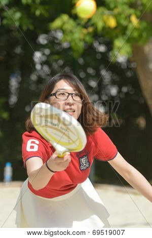 MOSCOW, RUSSIA - JULY 18, 2014: China team captain Peng XiaoLei on the training during the ITF Beach Tennis World Team Championship. Russia hosts the championship for the third time