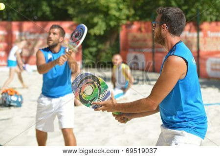 MOSCOW, RUSSIA - JULY 19, 2014: Men double of Greece in the match against Thailand during ITF Beach Tennis World Team Championship. Greece won in two sets