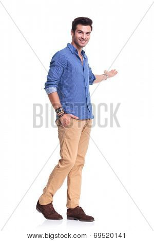 happy casual man presenting something on white background, full body picture