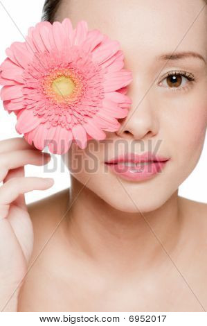 Young And Attractive Woman With Flower