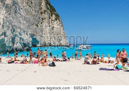 Tourists at the Navagio Beach in Zakynthos Greece