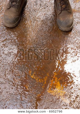 Boots On Wet Rusty Ground