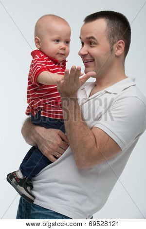 Father holding his son, cute baby boy