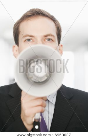 Handsome Young Businessman With Bullhorn