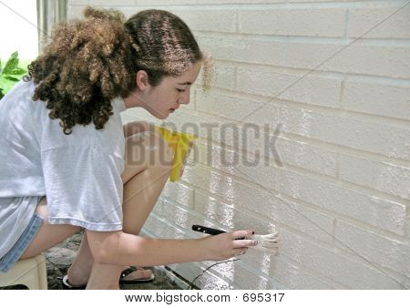 Teen Painting House Trim
