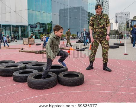 Kids Running Military Obstacle Course