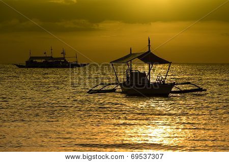 Philippine Tourist Boat Sails On The Sea At Sunset.