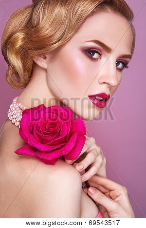 Lady with pink rose.
