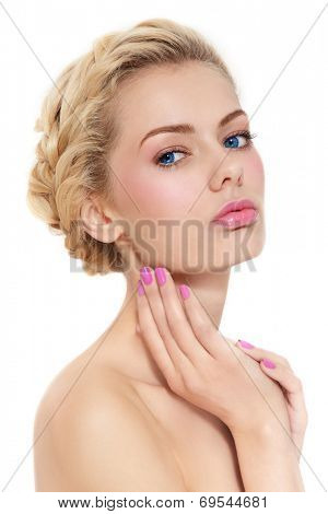 Young beautiful blond girl with fresh pink make-up and manicure over white background
