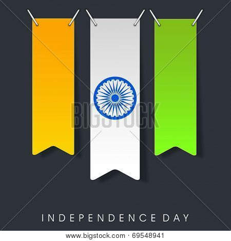 Shiny national tricolors stripe with Asoka Wheel on grey background for 15th of August, Indian Independence Day celebrations.