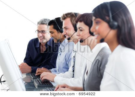 Confident Business People Using Headset