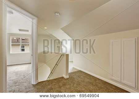 Empty Upstairs Hallway With Stairs