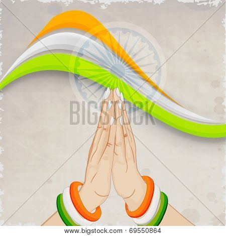 Poster, banner or flyer with national tricolors wave, Asoka wheel and lady hands in Indian gesturing Namaste on grungy grey background for 15th of August, Indian Independence Day celebrations.