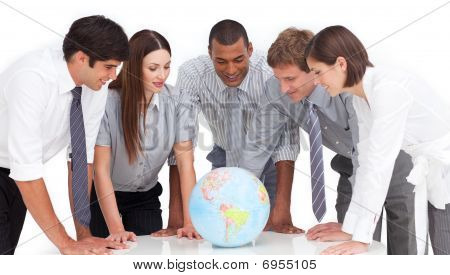 A Meeting Of Business Team Around A Terrestrial Globe