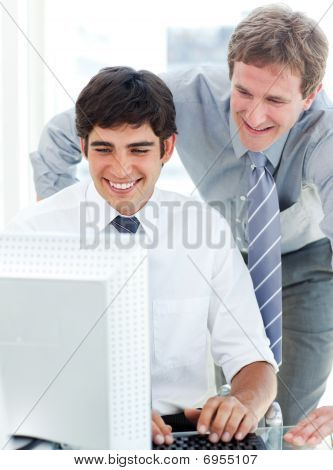 Two Serious Businessmen Working At A Computer