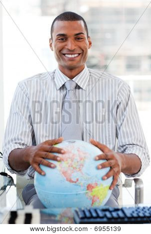 Enthusiastic Businessman Showing A Terrestrial Globe