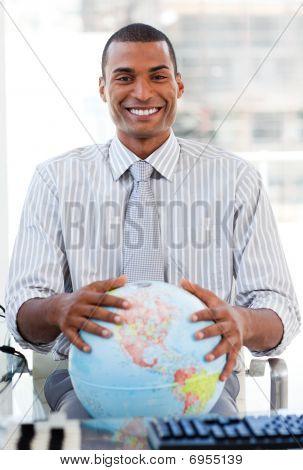 Enthusiastic Businessman Showing A Terrestrial Globe